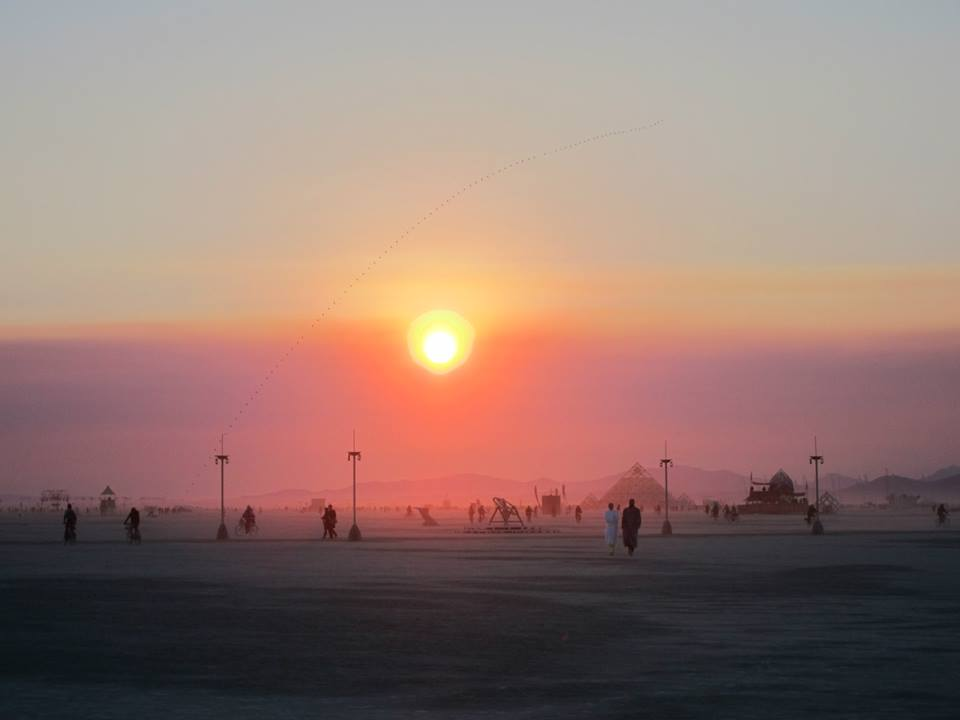 Sunrise at Burning Man ( photo by Andrew Torr)