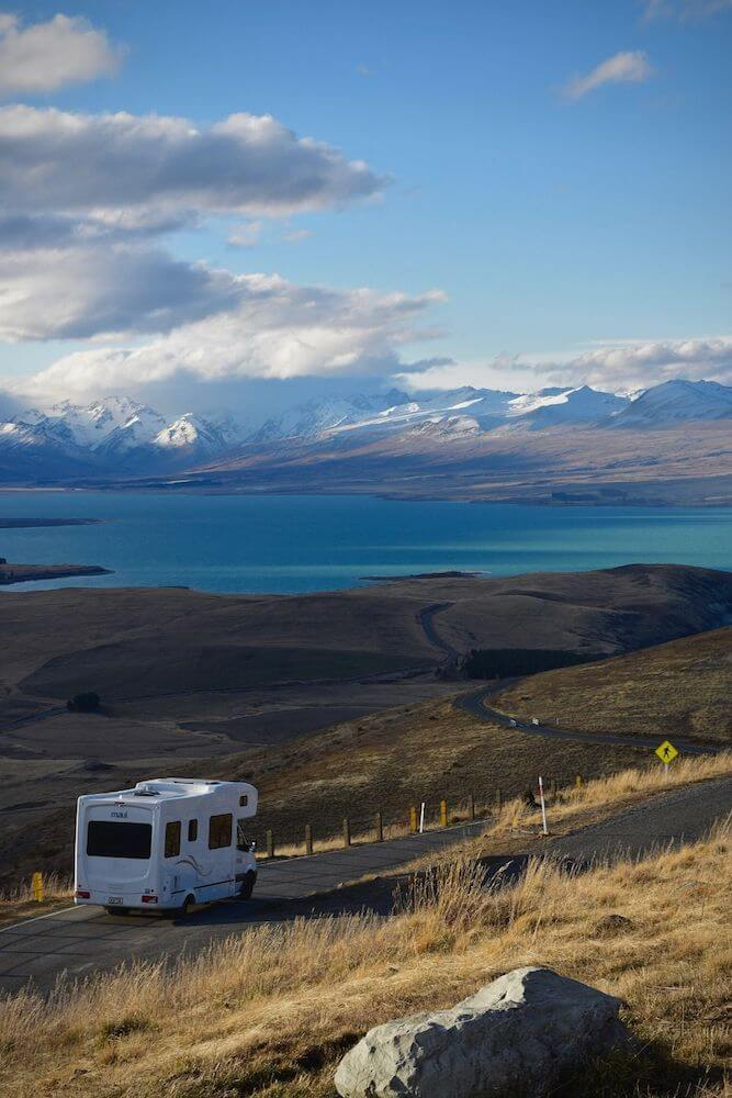 RV on road with scenic view