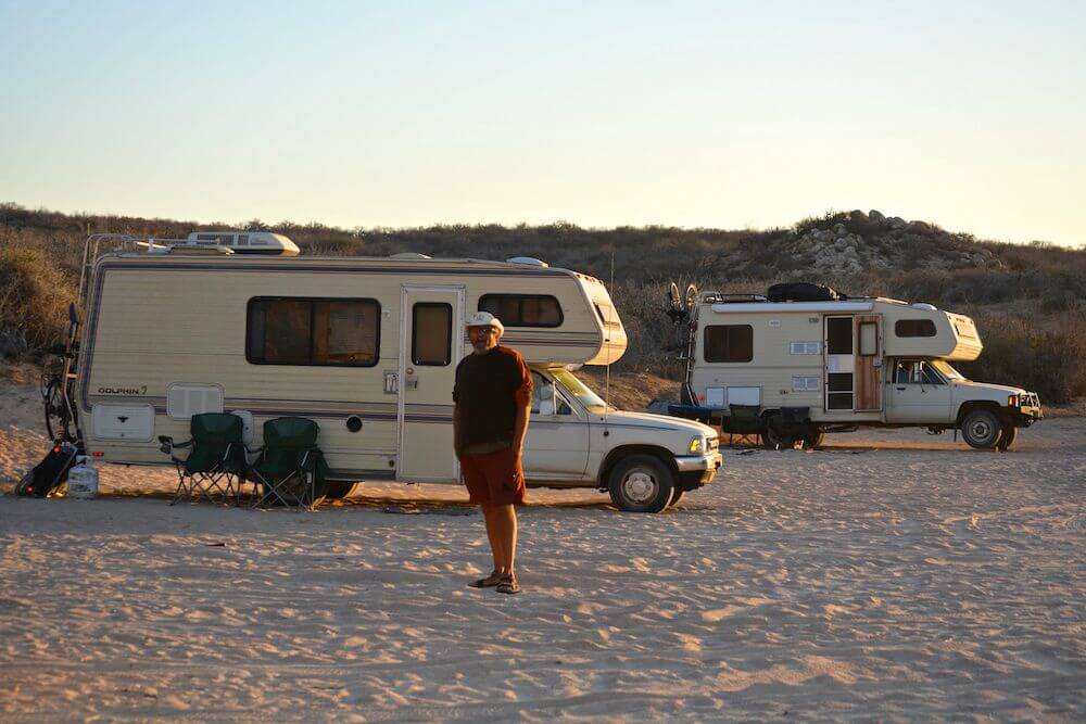 Two RVs dry camping on sand