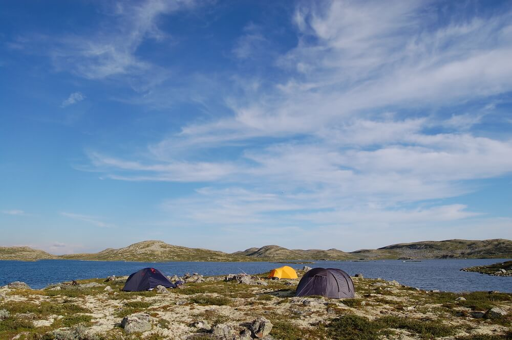 Camping tents in a coast with water