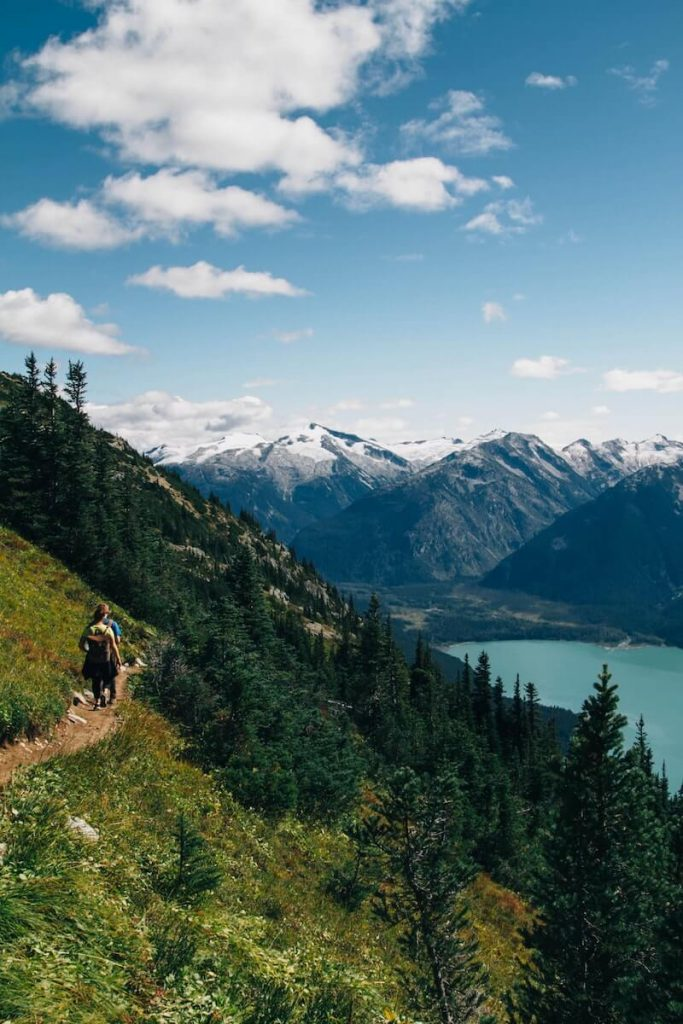 Hiker on a trail with mountains
