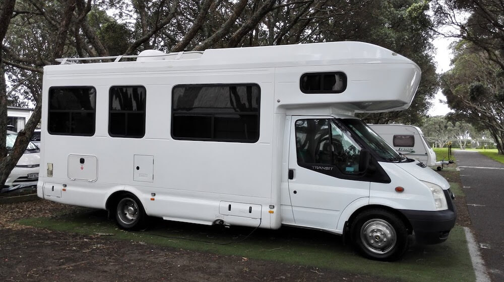 Class C RV parked in RV campsite