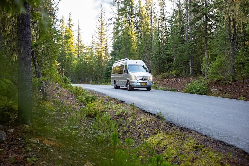 RV van on forest road in the United States