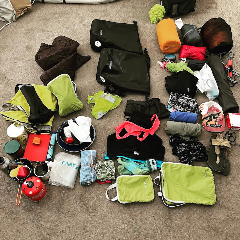 Pile of gear to be packed for Pacific Coast bike tour