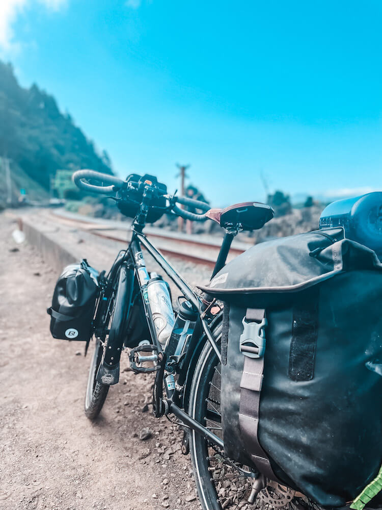 Close up of loaded touring bicycle on the Pacific Coast bicycle route