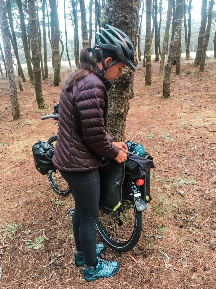 Brittany adjusting her bicycle panniers