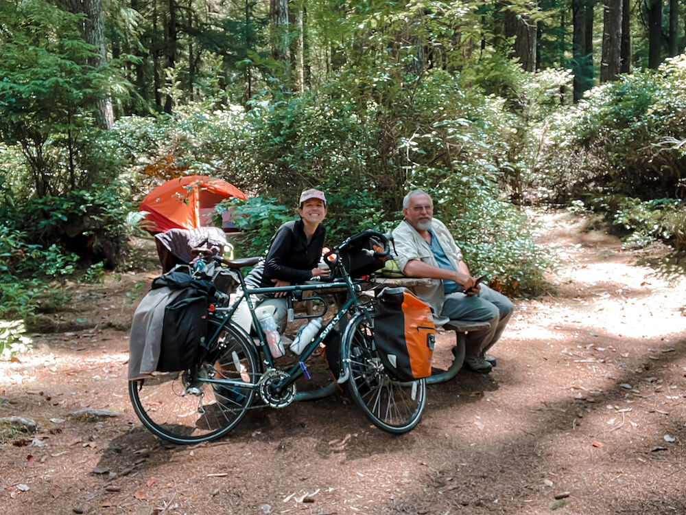 Brittany and Tom in a hiker biker campsite with bicycles